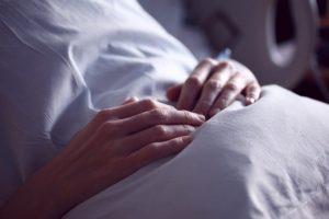 Healing Patient Holding Pillow